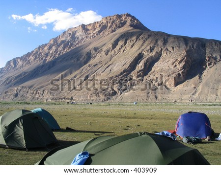 Campsite - dry river bed India - stock photo