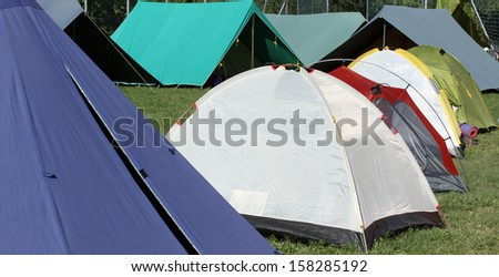 campsite with many tents and igloo for people - stock photo