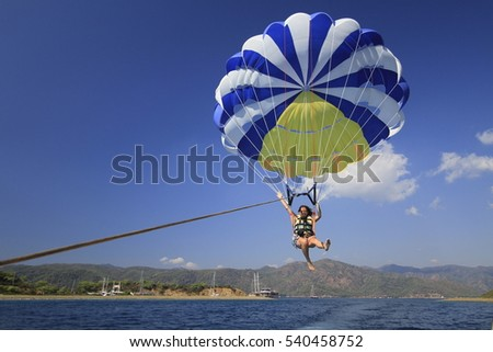CAMYUVA, KEMER, TURKEY - JULY 16, 2016: The team prepares a parachute for parasailing. Parasailing is very popular in the Turkish resorts
