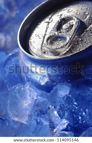 can of bear in ice cube - stock photo