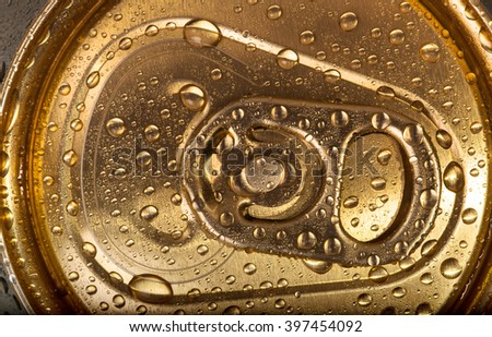 Can of beer with condensation on top - stock photo