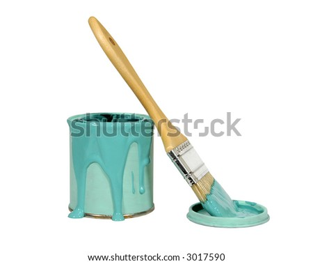 can of green paint with paint brush resting on lid on a white background - stock photo