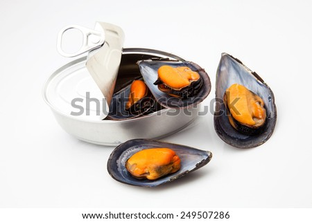 can of mussels cooked in their shells - stock photo