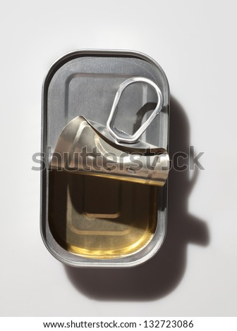 Can of sardines empty and open on white background - stock photo