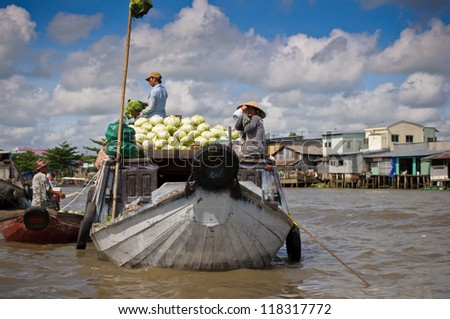 """CAN THO,VIETNAM-APRIL 14: Cai Rang Floating Market, 6km from Can Tho,  most famous and biggest floating market in Mekong Delta with hundreds of boats packed on April 14, 2012 in Can Tho, Vietnam."""" - stock photo"""