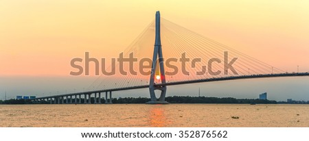 Can Tho, Vietnam - April 4th, 2015: Beauties of cable stayed bridge at sunset with the sun in the abutment expressed shining achievements of human development in rural Mekong Delta in Can Tho, Vietnam - stock photo