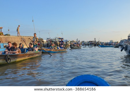 CAN THO, VIETNAM- AUG 22: Unidentified Vietnamese persons during the Floating Market in Can Tho, Vietnam on August 22, 2015. Cai Rang Market is the most important floating market on the Mekong Delta - stock photo