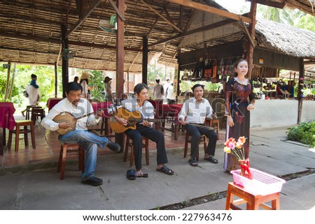 Can Tho, Vietnam - May 18, 2013: Artists perform music and song to tourists. The art is an indispensable part of the spiritual activity and cultural heritage of the people of southern Viet Nam