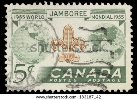CANADA - CIRCA 1955: A stamp printed by Canada, shows Globe and Scout Emblem, circa 1955 - stock photo