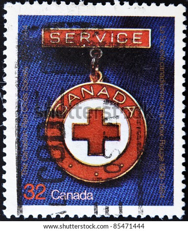 CANADA - CIRCA 1984: A stamp printed in Canada commemorating the anniversary of the Canadian of the Red Cross society, circa 1984 - stock photo