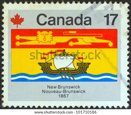 """CANADA - CIRCA 1979: A stamp printed in Canada from the """"Canada Day. Flags"""" issue shows New Brunswick flag, circa 1979. - stock photo"""