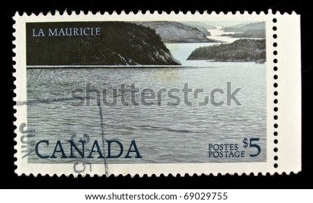 CANADA - CIRCA 1986: A stamp printed in Canada showing landscape with sea and mountains in Mauricie, circa 1986