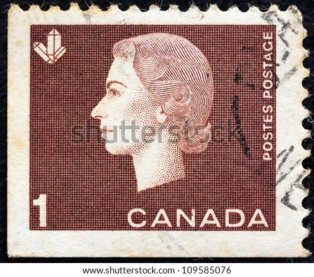CANADA - CIRCA 1962: A stamp printed in Canada shows a portrait of Queen Elizabeth II and Crystals Mining symbol, circa 1962. - stock photo