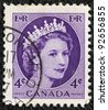 CANADA - CIRCA 1954: A stamp printed in Canada shows a portrait of Queen Elizabeth II, circa 1954. - stock photo