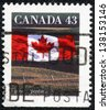 """CANADA - CIRCA 1991: A stamp printed in Canada shows Canadian flag and Prairie, without the inscriptions, from the series """"Canadian flag"""", circa 1991 - stock photo"""