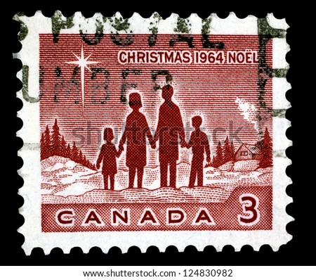 "CANADA - CIRCA 1964: A stamp printed in Canada shows Family and Star of Bethlehem, with the inscriptions ""Christmas"", from the series ""Christmas"", circa 1964"