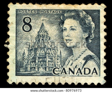 CANADA - CIRCA 1972: A stamp printed in Canada shows Queen Elizabeth II and Library of Parliament, circa 1972 - stock photo