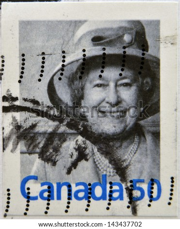 CANADA - CIRCA 2003: A stamp printed in Canada shows Queen Elizabeth II, circa 2003 - stock photo