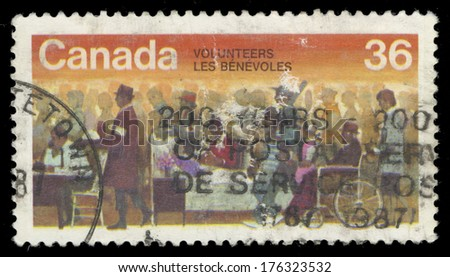 CANADA - CIRCA 1987: A stamp printed in Canada shows Volunteers, circa 1987 - stock photo