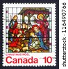 CANADA - CIRCA 1976: a stamp printed in the Canada shows Nativity, Stained-glass Window, St. Jude, London, Ontario, circa 1976 - stock photo