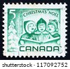 CANADA - CIRCA 1967: a stamp printed in the Canada shows Singing Children and Peace Tower, Ottawa, Christmas, circa 1967 - stock photo
