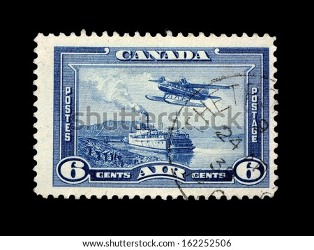CANADA, CIRCA 1939 - Post stamp of Canada with images of ship and airplane circa 1939 in Canada