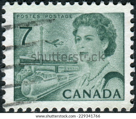 CANADA - CIRCA 1971: Postage stamp printed in Canada, shows Transportation Means, a portrait of Queen Elizabeth II, circa 1971 - stock photo