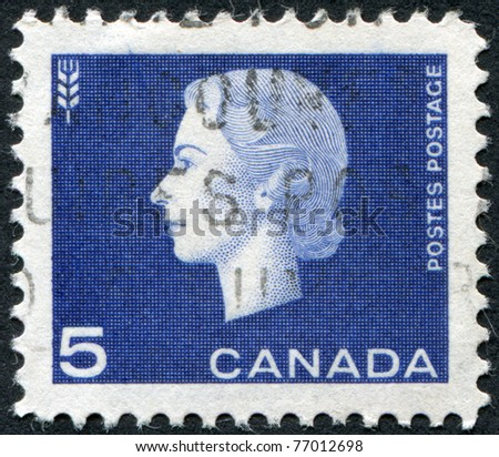 CANADA - CIRCA 1963: Postage stamps printed in Canada, depicts Queen Elizabeth II and thethe sign of wheat , circa1963
