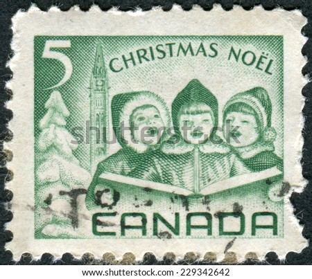 CANADA - CIRCA 1967: Postage stamps printed in Canada, depicts Singing Children and Peace Tower, Ottawa, circa 1967 - stock photo