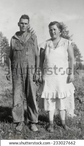 CANADA - CIRCA 1920s: An antique photo shows  portrait of a farmer and his wife - stock photo