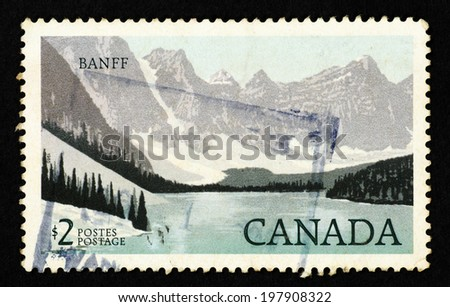 CANADA - CIRCA 1985: Stamp printed in Canada with landscape image of Banff National Park in the Canadian Rockies. - stock photo