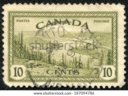 CANADA - CIRCA 1955: Stamp printed in Canada with landscape image of the Yukon River, circa 1955.