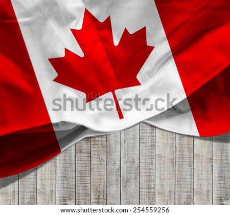 Canada flag and wood background - stock photo