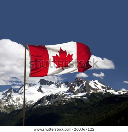 Canada Flag by Coast Mountains, British Columbia, Canada - stock photo