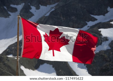 Canada Flag by the Rocky Mountains - stock photo
