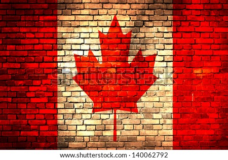 Canada flag on brick wall - stock photo