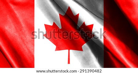Canada flag on soft and smooth silk texture - stock photo