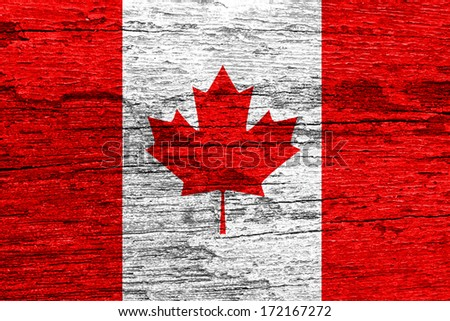 Canada flag on wood texture  - stock photo