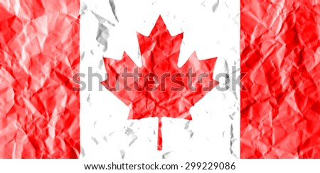 Canada flag painted on crumpled paper background. - stock photo