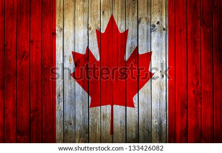 canada flag painted on old wood background - stock photo