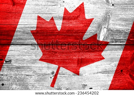 Canada flag painted on old wood plank background - stock photo