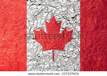 Canada Flag with a Shiny  leaf  Bronze Shiny  leaf   foil texture background - stock photo