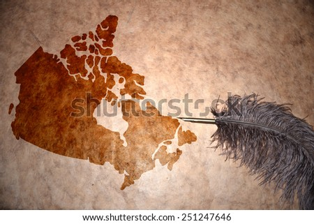 Canada map on vintage paper with old pen - stock photo