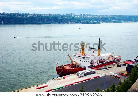 CANADA, QUEBEC CITY- JULY 20, 2014: Canadian coast guard Des Groseillers vessel on the St.Lawrence docked in Quebec city. The Coast guard is responsible for 2.3 million nautical miles2 (8 million km2) - stock photo
