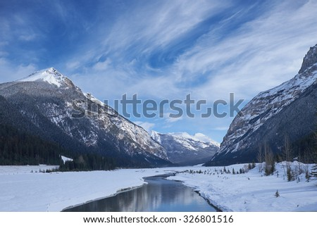 Canada Rocky Mountains with lake & reflections in winter - stock photo
