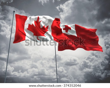 Canada & Tonga Flags are waving in the sky with dark clouds