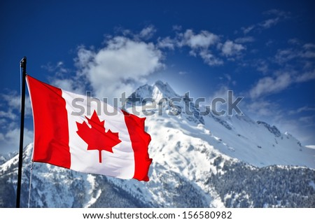 Canadian flag and beautiful mountain landscape - stock photo