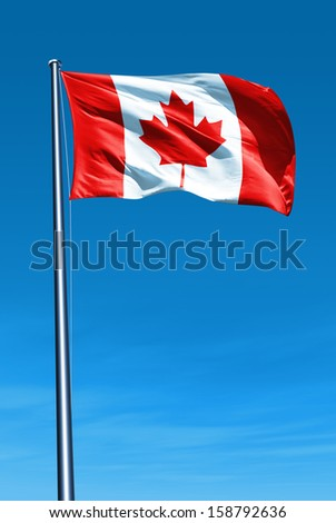 Canadian flag waving on the wind - stock photo