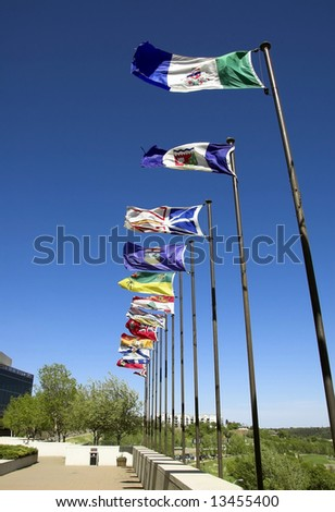 Canadian flags along the river valley - stock photo