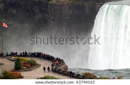 Canadian observation area next to the Horseshoe Falls, Niagara Falls, Ontario, Canada. - stock photo